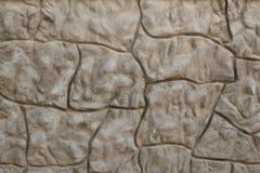 Golvende (grijze) steenmuur Stock Afbeeldingen
