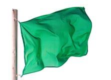 Golvende groene vlag over wit Stock Afbeelding