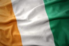 Golvende kleurrijke vlag van kooi D ` ivoire stock afbeeldingen