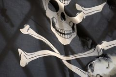 Golvende piraatvlag heel Roger royalty-vrije stock afbeelding