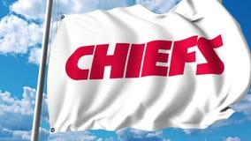 Golvende vlag met embleem van het Kansas City Chiefs het professionele team Het redactie 3D teruggeven Stock Fotografie