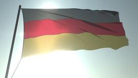 Golvende vlag van Duitsland tegen glanzende zon en hemel Realistische loopable 3D animatie stock video