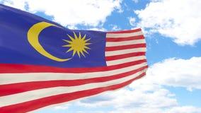 Golvende vlag van Maleisië op blauwe bewolkte hemel royalty-vrije stock foto's