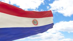 Golvende vlag van Paraguay op blauwe bewolkte hemel stock foto's