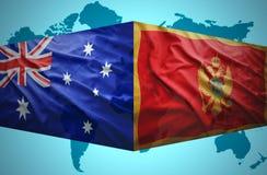 Golvende vlaggen Van Montenegro en Australische Stock Foto's