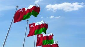 Golvende vlaggen van Oman tegen de hemel stock video