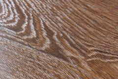 Golvet av den bruna laminaten Bakgrund Arkivbilder