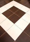 golvet gjorde tegelplattor Royaltyfri Bild