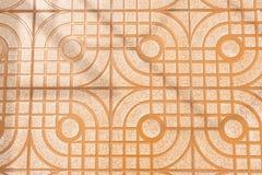 Golvtegelplattor med linjer och kurvmodellskugga av apelsinen Royaltyfri Fotografi