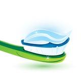 Goma de diente en cepillo Fotografía de archivo