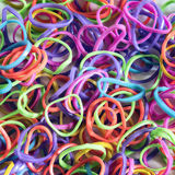 Gomas coloridas al pleteniyav como fondo imagen de archivo libre de regalías