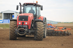 GOMEL, BELARUS - 19 APRIL 2017: Belarus tractor cultivates a piece of land. GOMEL, BELARUS - 19 APRIL 2017: Belarus tractor cultivates a piece of land Royalty Free Stock Photos
