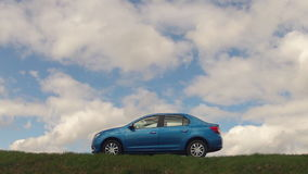 GOMEL, BELARUS - 16 April 2017: The car is parked in the field against the sky with clouds.  stock footage