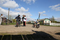 Gomel, Belarus - April 27, 2016: the life of Belarusian children in the village Derbichi. Cycling. April 27, 2016 in the village o Stock Photography
