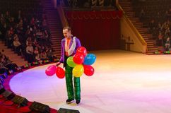 Moscow circus on ice on tour. Clown with balloons on arena. GOMEL, BELARUS - APRIL 10, 2015: Moscow circus on ice on tour. Clown with balloons on arena Royalty Free Stock Image