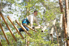 Gomel, Belarus - 30 April, 2017: Rope town for a family holiday in the countryside. Family competition to overcome aerial obstacle Stock Photography