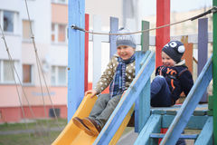 GOMEL, BELARUS - 6 April 2017: unfamiliar children play on the playground in early spring. Royalty Free Stock Photography