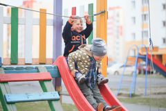 GOMEL, BELARUS - 6 April 2017: unfamiliar children play on the playground in early spring. Stock Photos