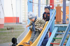 GOMEL, BELARUS - 6 April 2017: unfamiliar children play on the playground in early spring. Stock Photo
