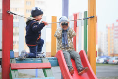 GOMEL, BELARUS - 6 April 2017: unfamiliar children play on the playground in early spring. Royalty Free Stock Photos