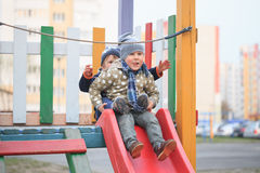 GOMEL, BELARUS - 6 April 2017: unfamiliar children play on the playground in early spring. Royalty Free Stock Photo