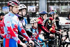 Young sportsmen in cycling. Gomel, Belarus. Gomel, Belarus - April 10, 2016: Young cycling sportsmen are preparing for the start of the race at the bikes in Royalty Free Stock Photography