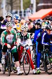 Sportsmen with bicycles on Lenin Square. Gomel, Belarus. Gomel, Belarus - April 10, 2016: Young sportsmen on the bike ready for the start Stock Photos