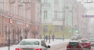 Gomel, Belarus. City Traffic On Sovetskaya Street In Winter Snowy Snowstorm Day. Pan, Panorama. Gomel, Belarus - January 28, 2018: City Traffic On Sovetskaya stock footage