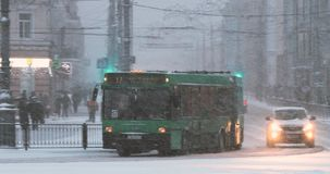 Gomel, Belarus. City Traffic On Sovetskaya Street In Winter Snowy Snowstorm Evening Time. Pan, Panorama.  stock video footage