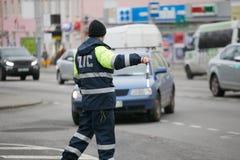 GOMEL, BELARUS - December 18, 2017: Officer of the road patrol service with a baton.. GOMEL, BELARUS - December 18, 2017: Officer of the road patrol service Royalty Free Stock Images