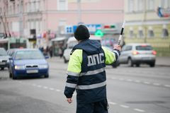 GOMEL, BELARUS - December 18, 2017: Officer of the road patrol service with a baton.. GOMEL, BELARUS - December 18, 2017: Officer of the road patrol service Royalty Free Stock Photo
