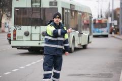 GOMEL, BELARUS - December 18, 2017: Officer of the road patrol service with a baton.. GOMEL, BELARUS - December 18, 2017: Officer of the road patrol service Royalty Free Stock Image