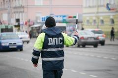 GOMEL, BELARUS - December 18, 2017: Officer of the road patrol service with a baton.. GOMEL, BELARUS - December 18, 2017: Officer of the road patrol service Stock Image