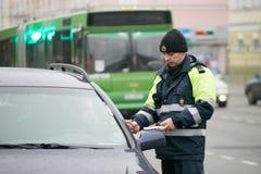 GOMEL, BELARUS - December 18, 2017: Officer of the road patrol service with a baton.. GOMEL, BELARUS - December 18, 2017: Officer of the road patrol service Stock Photo