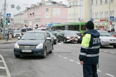 GOMEL, BELARUS - December 18, 2017: Officer of the road patrol service with a baton.. GOMEL, BELARUS - December 18, 2017: Officer of the road patrol service Royalty Free Stock Photography