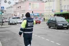 GOMEL, BELARUS - December 18, 2017: Officer of the road patrol service with a baton.. GOMEL, BELARUS - December 18, 2017: Officer of the road patrol service Royalty Free Stock Photos