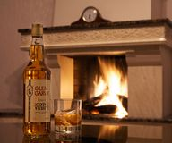 GOMEL, BELARUS - February 5, 2011: alcoholic products of the Gomel distillery on the background of the fireplace. GOMEL, BELARUS - February 5, 2011: alcoholic stock photo