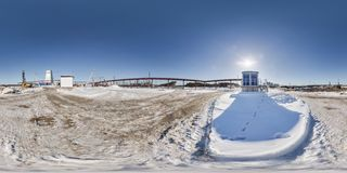GOMEL, BELARUS - FEBRUARY, 2017: full seamless panorama 360 angle view in winter snow field place site construction of a mining stock photos