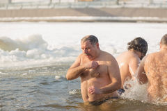 Gomel, Belarus - JANUARY 19, 2017: Bathing in the hole Orthodox people on holiday Baptism of Christ. Royalty Free Stock Photography