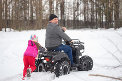 GOMEL, BELARUS - JANUARY 15, 2017: Country winter family holiday. Quad biking in the winter. Royalty Free Stock Photos