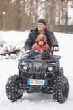 GOMEL, BELARUS - JANUARY 15, 2017: Country winter family holiday. Quad biking in the winter. Stock Images