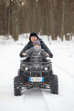 GOMEL, BELARUS - JANUARY 15, 2017: Country winter family holiday. Quad biking in the winter. Royalty Free Stock Images