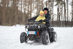 GOMEL, BELARUS - JANUARY 15, 2017: Country winter family holiday. Quad biking in the winter. Stock Photo