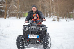 GOMEL, BELARUS - JANUARY 15, 2017: Country winter family holiday. Quad biking in the winter. Royalty Free Stock Image