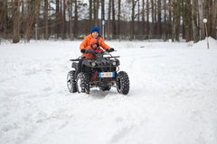GOMEL, BELARUS - JANUARY 15, 2017: Country winter family holiday. Quad biking in the winter. Royalty Free Stock Photography
