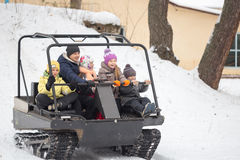 GOMEL, BELARUS - JANUARY 15, 2017: Country winter family holiday. Riding all-terrain vehicle in the winter. Royalty Free Stock Images