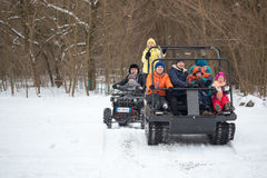 GOMEL, BELARUS - JANUARY 15, 2017: Country winter family holiday. Riding all-terrain vehicle in the winter. Royalty Free Stock Image