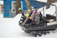 GOMEL, BELARUS - JANUARY 15, 2017: Country winter family holiday. Riding all-terrain vehicle in the winter. Royalty Free Stock Photo