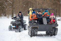 GOMEL, BELARUS - JANUARY 15, 2017: Country winter family holiday. Riding all-terrain vehicle in the winter. Royalty Free Stock Photography