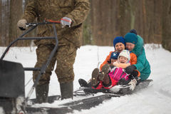 GOMEL, BELARUS - JANUARY 15, 2017: Winter fun. Family sledging hunting snowmobile. Stock Images